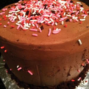 Custom Vegan and Gluten free cake with chocolate icing and sprinkles